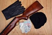 stock photo of smuggling  - Bags of drugs euro money and gun on a wooden table - JPG
