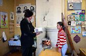 Rural School In Russia, The Teacher Teaches Schoolgirl.