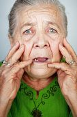 image of old lady  - Portrait of scared and worried senior wrinkled lady - JPG