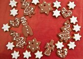 foto of ginger bread  - Ginger bread and cinnamon cookies on red background - JPG