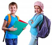 Pupils Of Grade School With Backpack And Books
