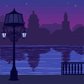 Illustration of city skyline at nigh: quay and silhouette of lamppost