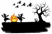 Witches Dancing Around The Fire At Halloween