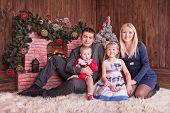 Happy Family Near Decorated Christmas Tree