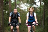Man And Woman Cyclist Smiling Outdoors