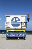 stock photo of beach hut  - Miami Beach sign at lifeguard hut in south beach - JPG