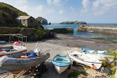 Boats in Mullion harbour The Lizard Cornwall UK situated on Mounts Bay near Helston