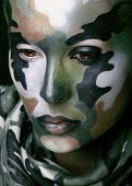 Beautiful young fashion woman with military style clothing and face paint make-up, khaki colored