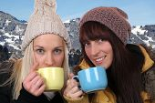 Young Women Drinking Cup Of Tea Outdoor In The Mountains