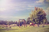 Retro Vintage Style Picture Of Playground In Park.