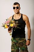Young soldier with bouquet of flowers