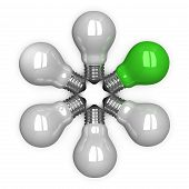 green Tungsten Light Bulb Among White Ones Lying Radially
