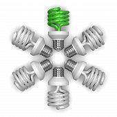 green Spiral Light Bulb And White Ones Lying Radially