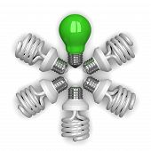 green Tungsten Light Bulb Among White Spiral Ones Lying Radially