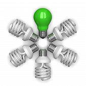 green Tungsten Light Bulb Among White Spiral Ones Lying Radially