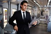 young executive going in train to work, businesspeople using technology for work