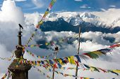 image of ganesh  - view from Langtang to Ganesh Himal with stupa and prayer flags and beautiful clouds  - JPG