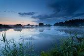 Misty Sunrise On River In Summer