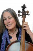 Woman Holding Cello Smiling