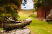stock photo of hobo  - Old shoe from a wanderar hobo in the countryside