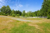 Farm Driveway With Wooden Fence In Olympia, Washington State