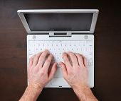 hands typing on a keyboard good for business designs or a layout background