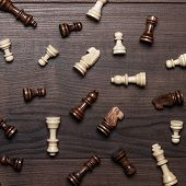 chess figures on the brown woden table background
