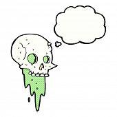 stock photo of gross  - gross halloween skull cartoon with thought bubble - JPG