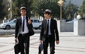 Ashgabad, Turkmenistan - October 10, 2014.  Two Cheerful Students In National Skullcaps