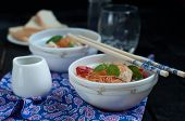 image of chopsticks  - Chinese asian noodles stir fry with vegetables served with a pair of chopsticks - JPG