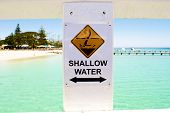 Shallow water sign on the beach