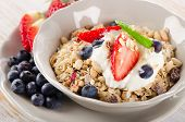 Healthy Breakfast With Ripe Berries, Yogurt And  Muesli.