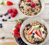 Muesli,  Fresh Berries And Yogurt For  Breakfast  On A Wooden Table