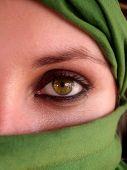 intense green eyes of arabian girl