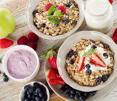 Muesli,  Fresh Berries And Yogurt For  Breakfast  On  Wooden Table