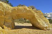 Natural stone arch on Armacao De Pera Beach