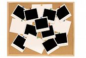 picture of bulletin board  - Cork notice or bulletin board with lots of blank instant camera photo prints and white office index cards - JPG