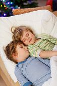 Two Little Blond Twins Boys Sleeping In Bed On Christmas