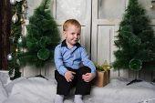 Boy And Christmas Tree