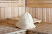 Traditional Wooden Sauna For Relaxation With Felt Hat