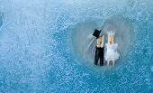 Romantic Couple. Man, Woman In Frozen Heart. Groom And Bride. Frozen Glass. Ice Flowers. Valentines