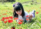 Girl Lying On A Meadow