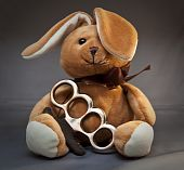 stock photo of brass knuckles  - Cute teddy bear with a pair of brass knuckles - JPG