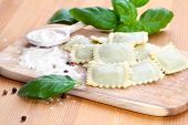Homemade Pasta Ravioli With Fresh Basil, Isolated Over Wooden Background.