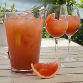 Постер, плакат: Grapefruit Lemonade Pitcher With Two Glasses Sliced Grapefruit On The Wooden Table Vintage Paper