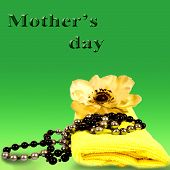 towel with beads and a flower in the background, mother's day