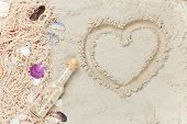 foto of beach shell art  - Cup of Cappuccino with heart shape symbol and net with shells on sand - JPG