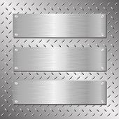 stock photo of plaque  - three silver brushed steel horizontal plaques on iron background  - JPG