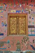 Beautiful mosaic and gold painted window at Xieng Thong temple in Luang Prabang, Laos.