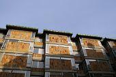 stock photo of tenement  - Brick building facade - JPG